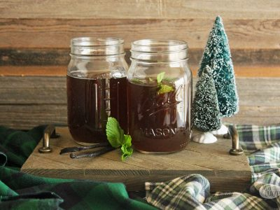 Snuggle up with a warm cup of Vanilla Mint Tea and some loved ones -- the perfect holiday entertaining non-alcoholic party drink everyone is sure to love | tea | sweet tea | hot tea | Milo's Tea | Fresh Mint Leaves | Vanilla Tea | Slow Cooker Recipes | Slow Cooker Beverages | Party Drinks | Beverage Recipes | Christmas | Holiday Drinks | Holiday Entertaining
