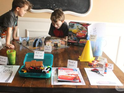Kids will love this educational Cars-themed activity table that is easy to set up for hours of fun learning | Disney Cars | Cars 3 | Kids Activities | Learning Activities | Car Activities | Rainy Day Activities | #kidsactivities #teachers #rainyday #earlychildeducation #homeschoolresources #activitytable #boardgames #cars3 #disney #k5 #2ndgrade #childhood101